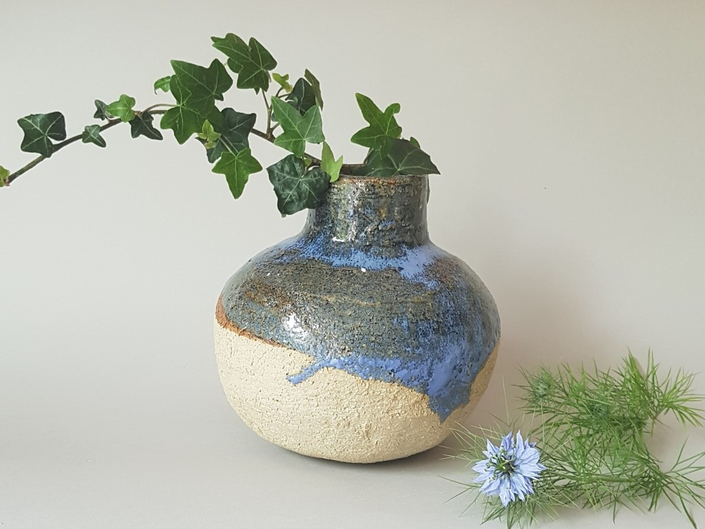 Blue and brown ceramic vase, with spring flowers