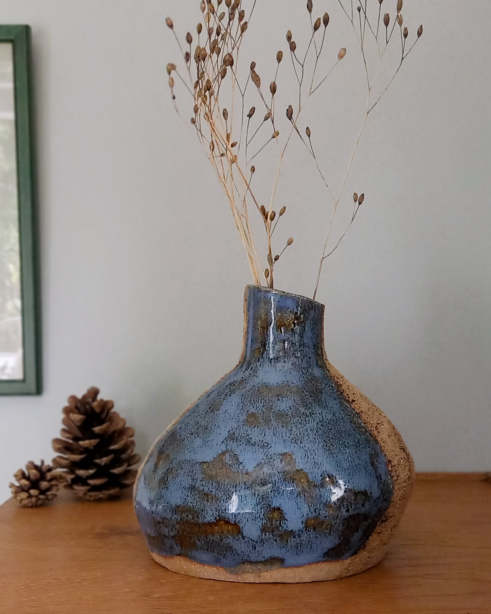 Ceramic vase with blue glaze and natural clay decoration